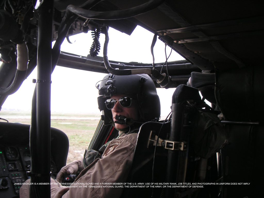 James in Helicopter Cockpit. James Mackler is a member of the Tennessee National Guard and a former member of the U.S. Army. Use of his military rank, job titles, and photographs in uniform does not imply endorsement by the Tennessee National Guard, the Department of the Army, or the Department of Defense.